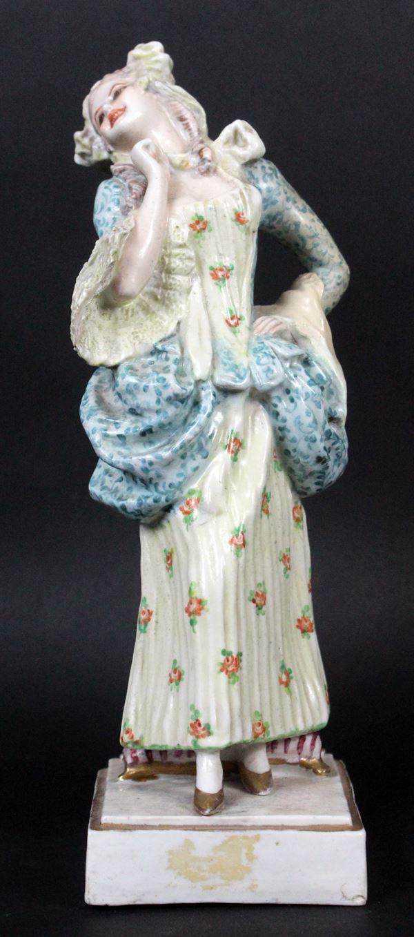 Figura di giovane dama, scultura in porcellana policroma, cm 26x9x9, manifattura Capodimonte, marcata N coronata sotto la base