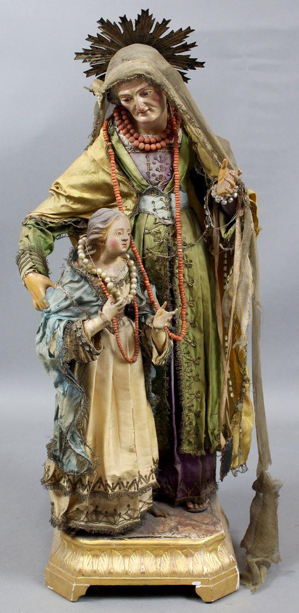 Sant'Anna con la Madonna, scultura in terracotta dipinta in policromia, vesti in tessuto ricamato, altezza cm. 69, Napoli, XIX secolo, (difetti).