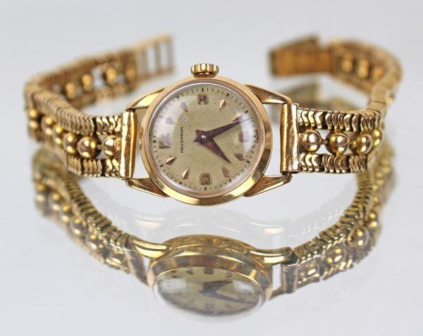 Orologio Hausmann da donna, cassa e cinturino in oro, gr. 29,2 (da revisionare).