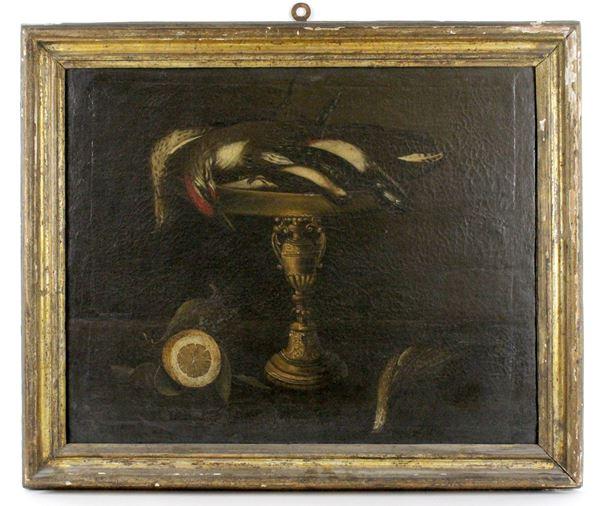 Pittore del XVII secolo, Natura morta con cacciaggione e limone, olio su tela, cm. 51,5x63, entro cornice coeva.